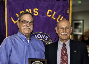 Lion Rick Siders Holds Lion of the Year Award Presented by President Kurt Peters