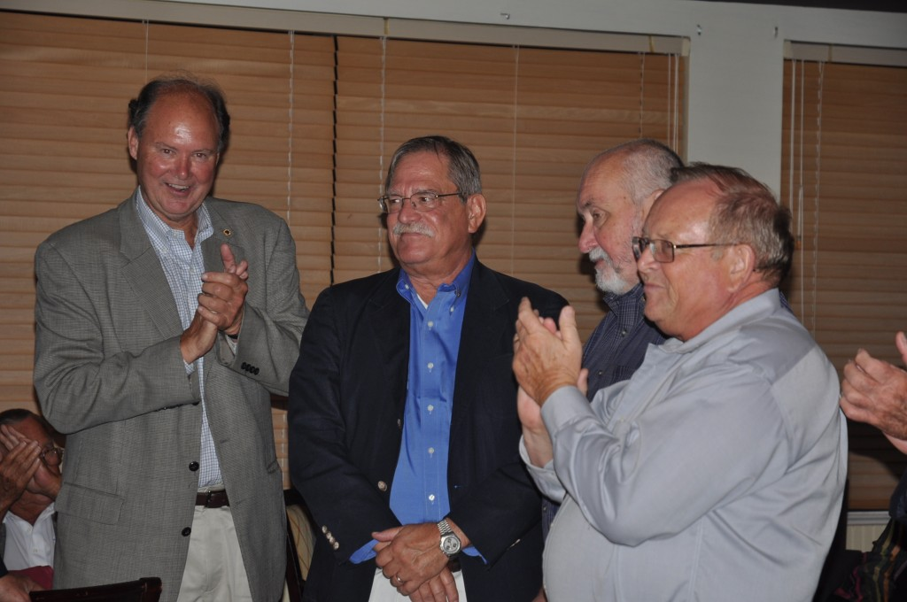 Lions Roger Grogman, left Mike Mallon and Cliff Nolan applaud their new President Rick Siders, center