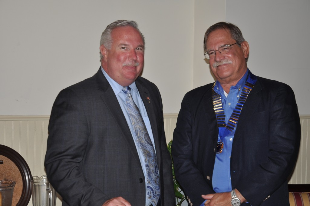 The Sanibel Captiva Lions Club's outgoing President Tom Hoover and new President, Rick Siders
