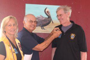 Sanibel Captiva Lions Club President Debi Almeida and Lion Tom Krekel welcome new Member Don Korn.